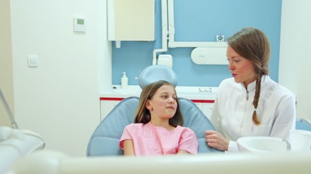 dentist talking with girl