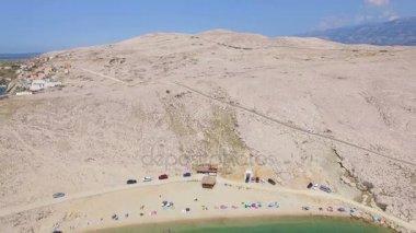 tourists on beach of Pag island, Croatia