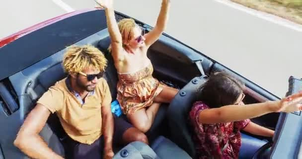 people driving in convertible