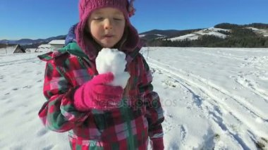 Girl eating a snow ball