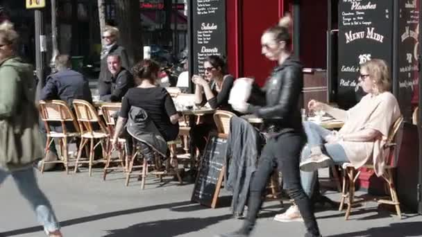 Busy street cafe in Paris