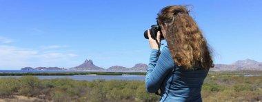 A Photographer Shoots Tetakawi Peak Rising Above San Carlos, the