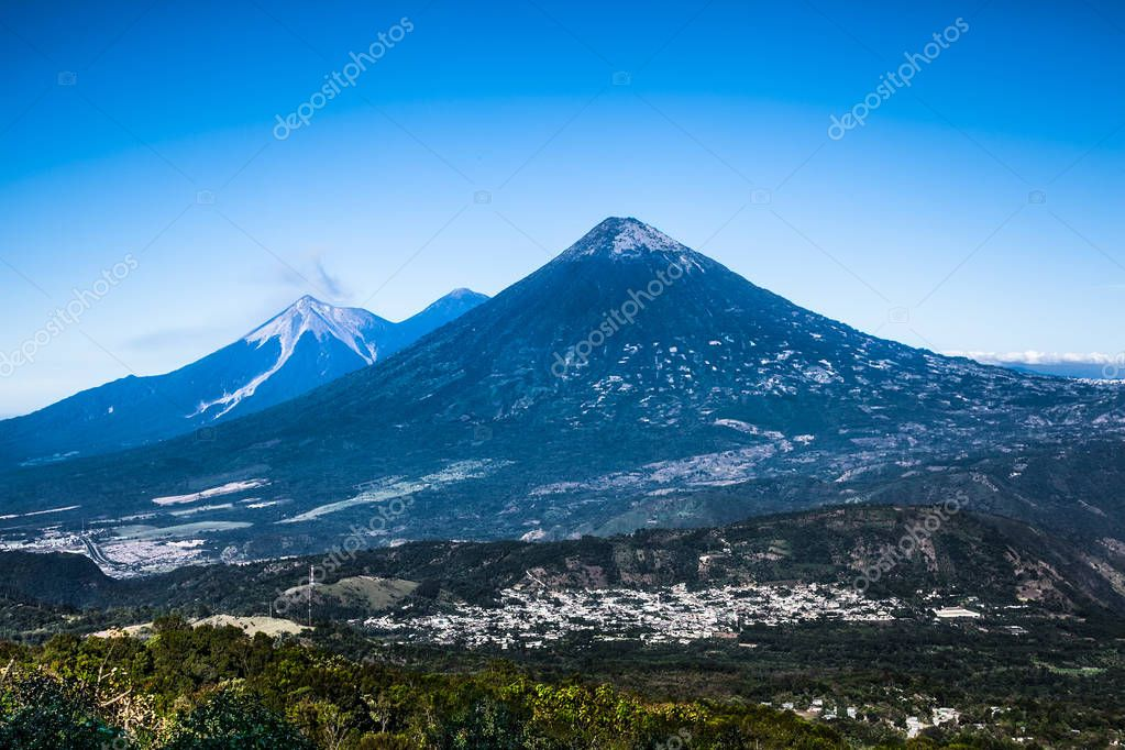 Volcans Aqua, Acatenango and Fuego (Fire volcano) erupts a cloud of ash and smoke near Antigua, Guatemala.