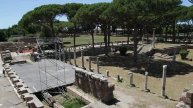 OSTIA ANTCA, ITALY -  JULY  2, 2017: Ancient Roman Theater in Ostia town built on both the sea and the Tiber river near Rome, this special position determined its relevance since 620 BCE.