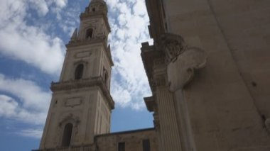 LECCE, ITALY -  JULY  27, 2017: baroque exterior of the Duomo dell Assunta , ancient Cathedral in the Historical Town center