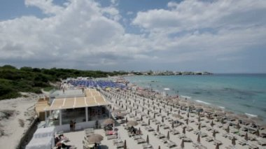 LECCE, ITALY -  JULY  26, 2017: the crowded beautiful beach of Torre dell Orso
