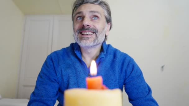 man lighting birthday candles