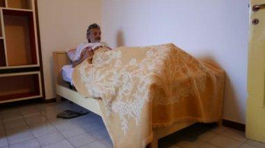 sleepless mature man in his bedroom, insomnia concept