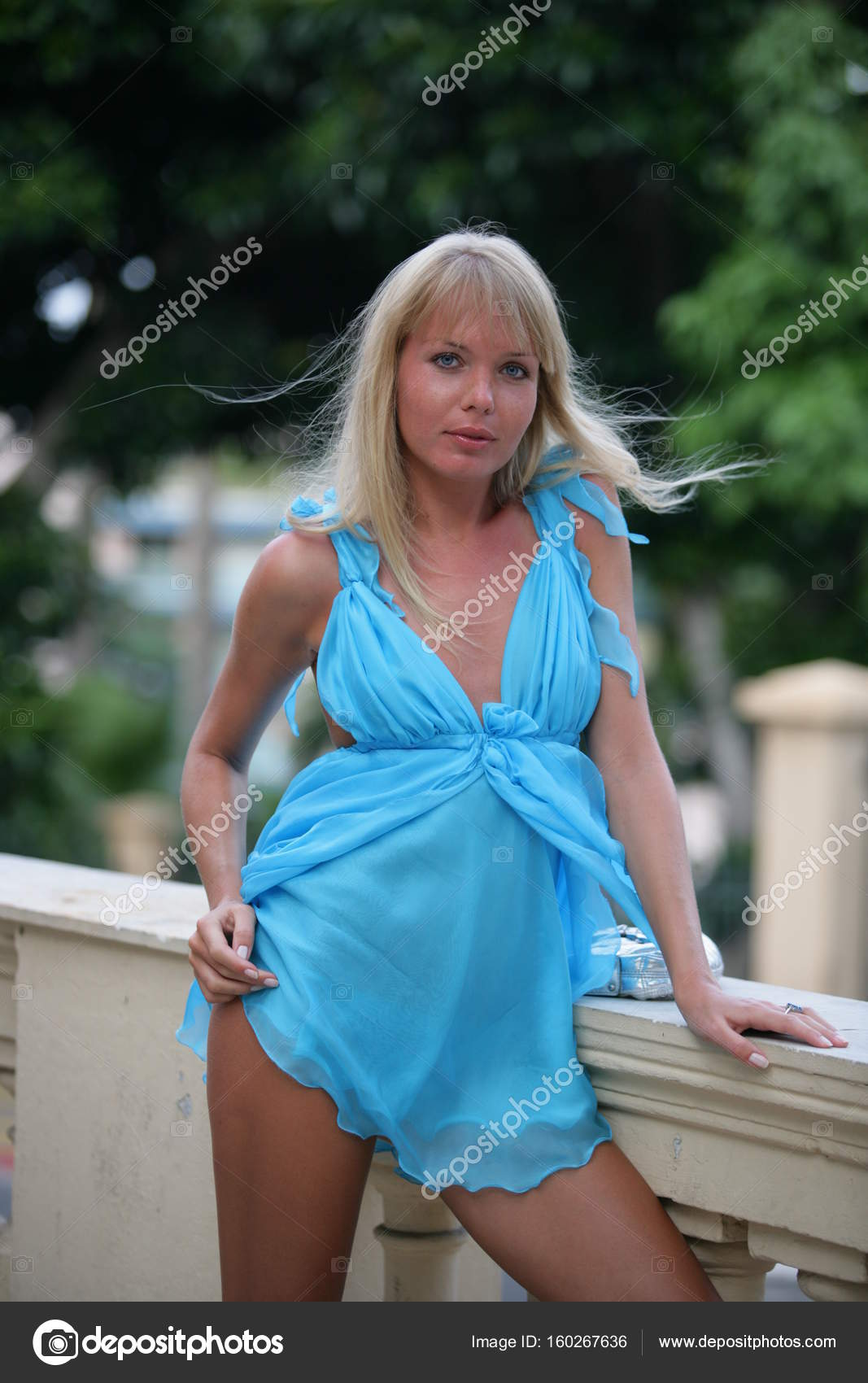 1106162635 Stunning young woman in beautiful short blue barbie dress walking around in  Monte Carlo — Stock