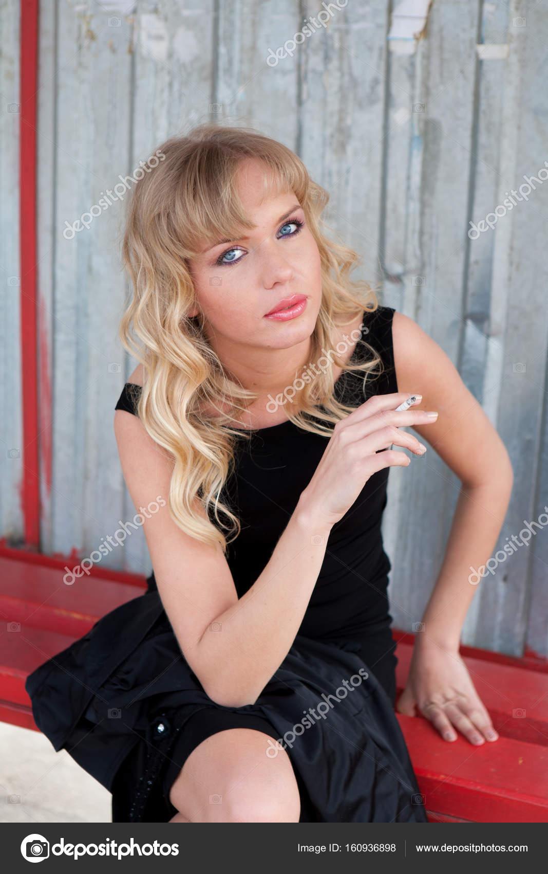 Beautiful female model in a gorgeous classic coat and pretty