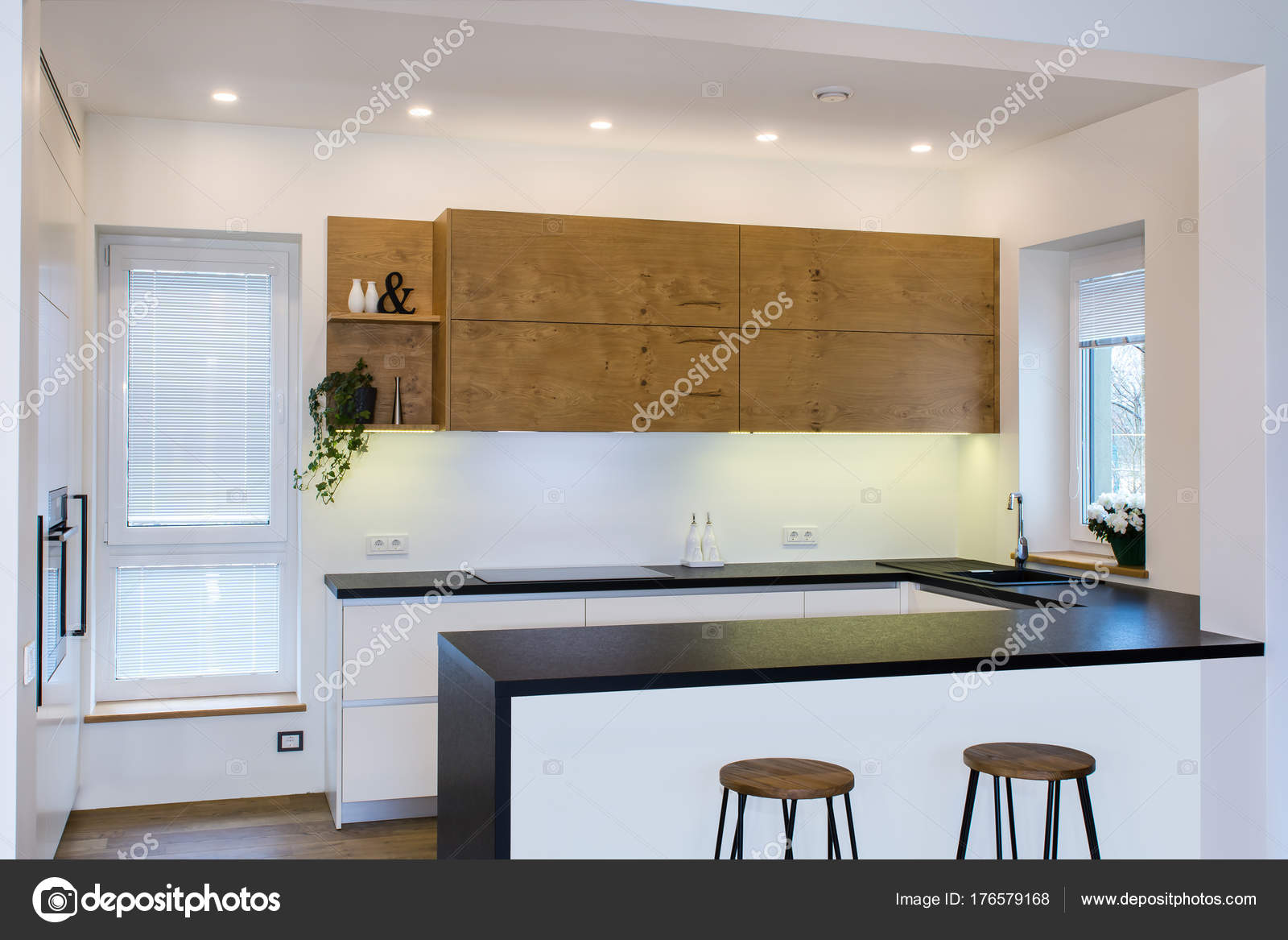 There is also a kitchen peninsula in the room kitchen and living room combined kitchen wood facades are made from walnut veneer
