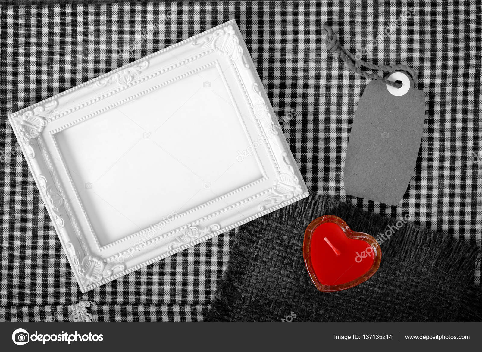 empty white frame next red heart sign from candle and paper tag ...