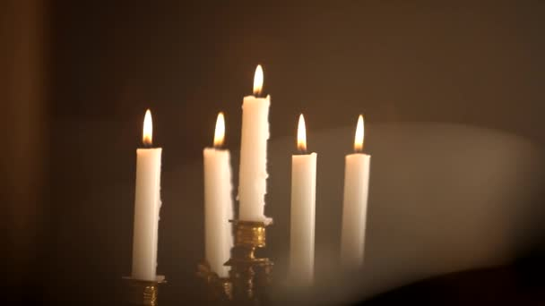 Blowing candlestick with candles