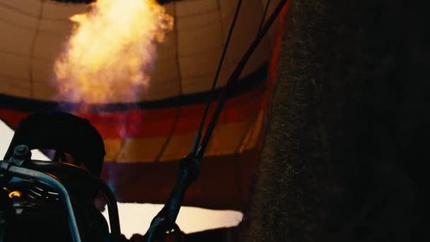 Hot air balloon. Fire bursts.