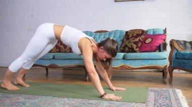 Female Doing A Downward Dog Stretch