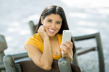 smiling woman using phone