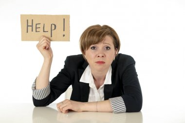 young beautiful red haired caucasian business woman overwhelmed and desperate holding a help sign. looking Stressed, bored, frustrated, upset and unhappy at work. business frustration concept.