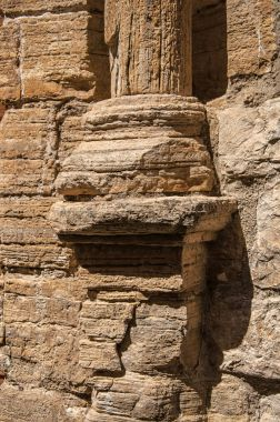 Close-up of old stone column base in Chteaudouble.