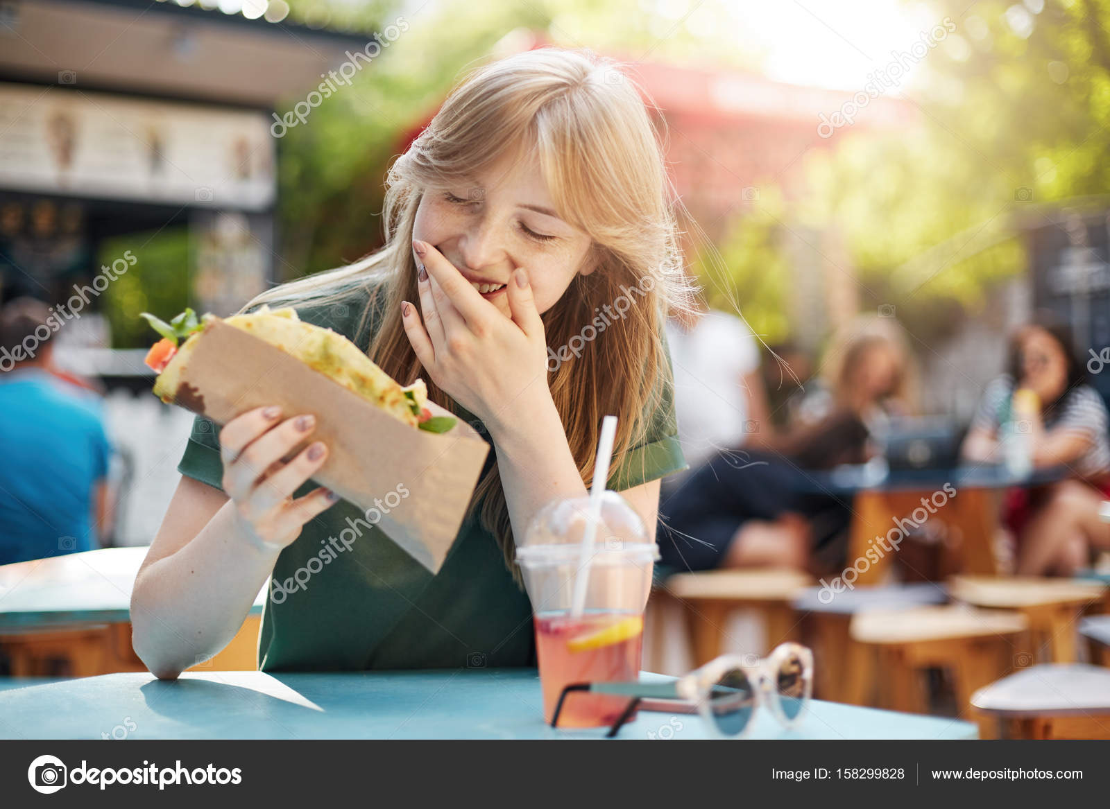 girl eating taco smiling hungry freckled blonde woman eating junk