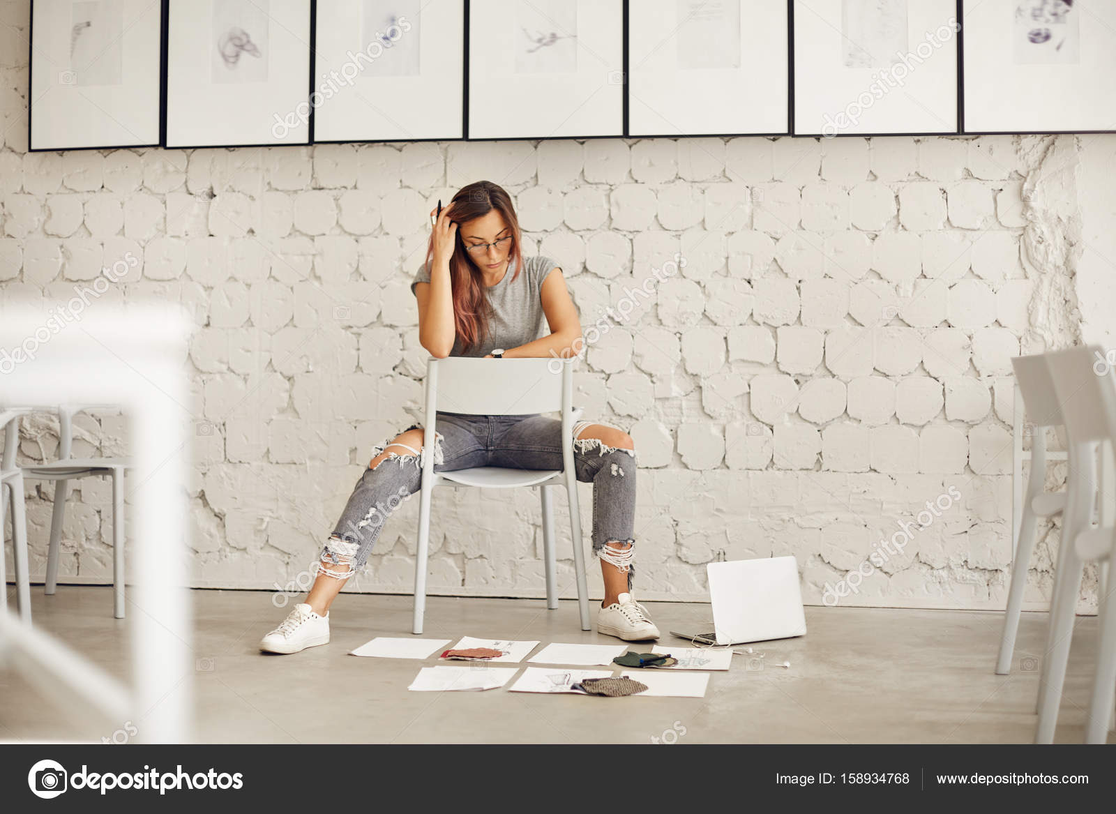 Aspiring Fashion Designer Thinking Of Textile And Sketches Scattered On Concrete Floor In Her New Studio Space Stock Photo C Ringsaroundme 158934768