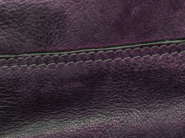 Violet leather background decorarated with a seam. Useful as background stock vector