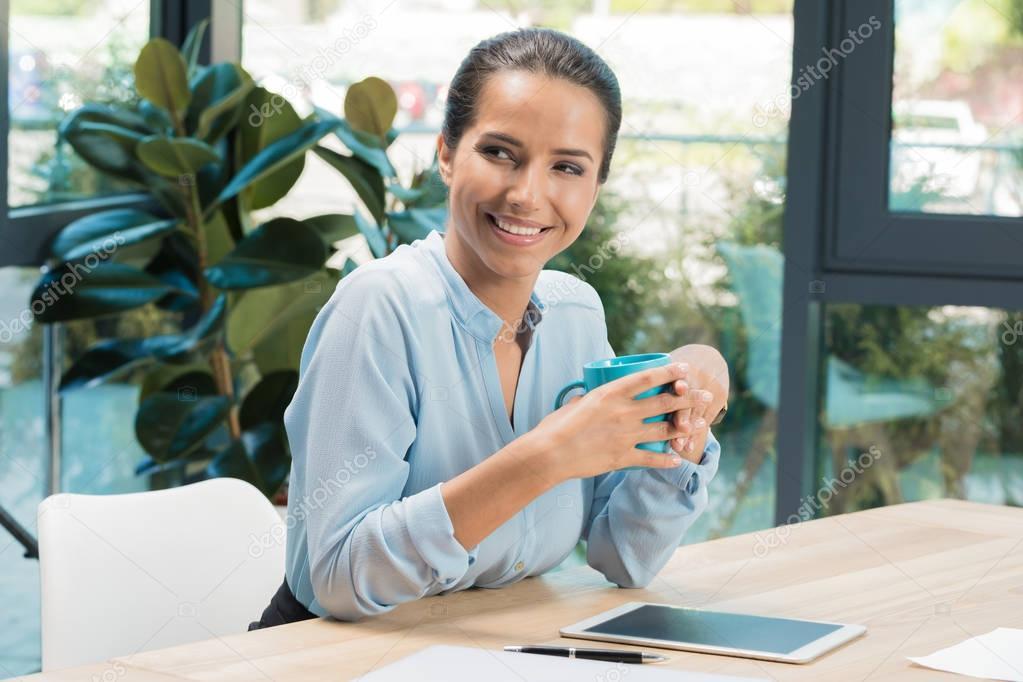 businesswoman sitting on workplace