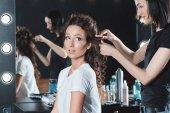 hair dresser doing hairstyle