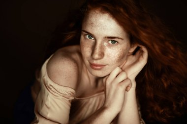 tender freckled redhead woman