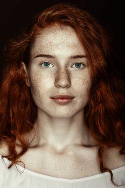 freckled redhead woman