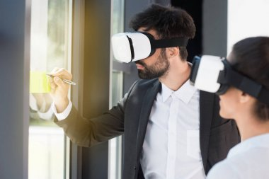 businesspeople in vr headsets