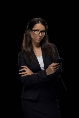 confident businesswoman with smartphone