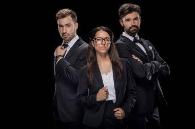 confident businesspeople in formalwear