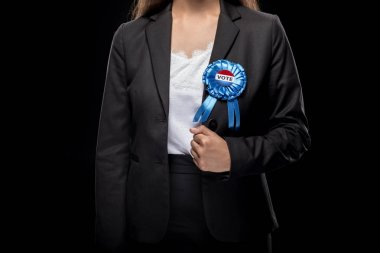 Businesswoman with vote badge