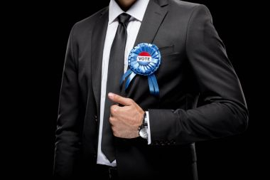 businessman with vote badge