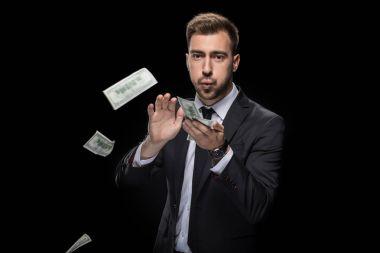 businessman throwing money