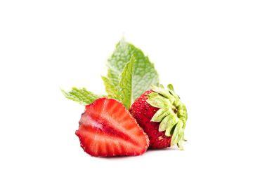 whole and half ripe strawberries