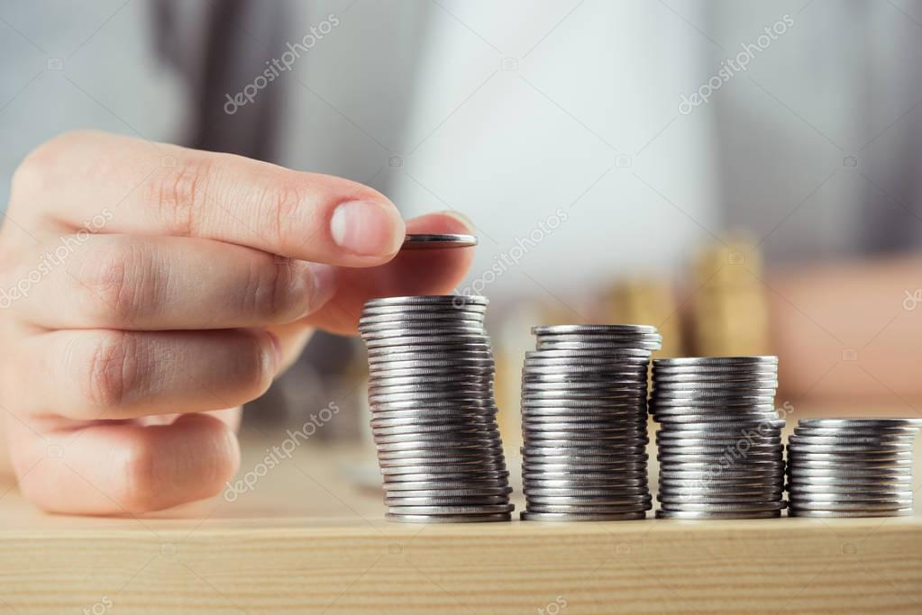 person stacking coins