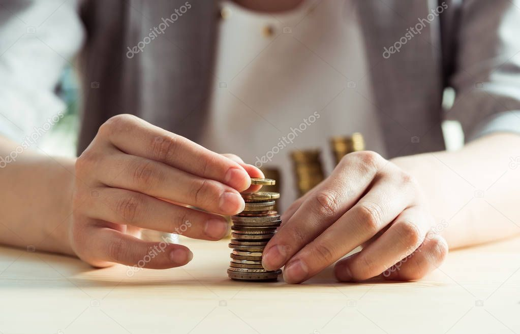 woman stacking coins