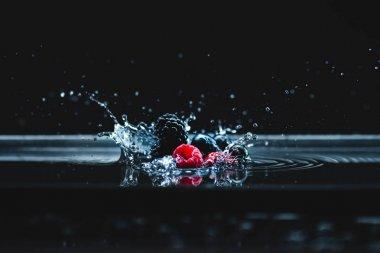 ripe berries falling in water