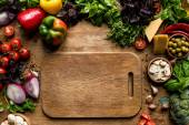 cutting board and fresh vegetables