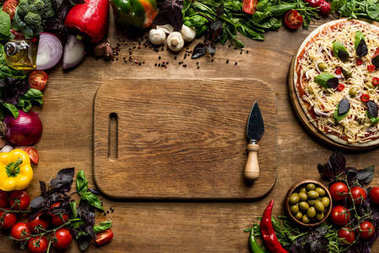 cutting board, pizza and ingredients