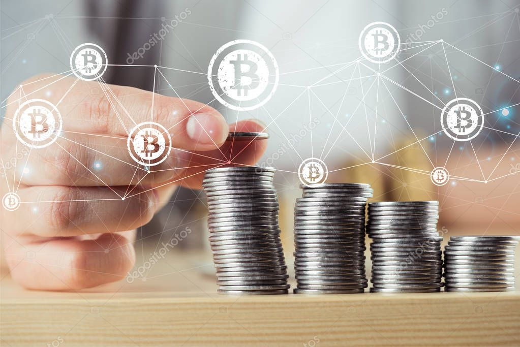 person stacking bitcoins
