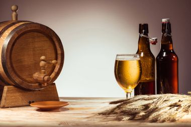 beer barrel, glass and bottles