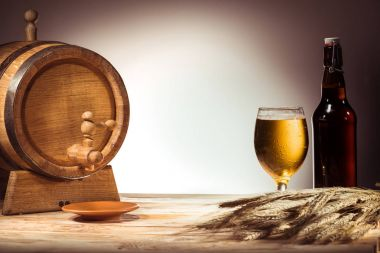beer barrel, glass and bottle