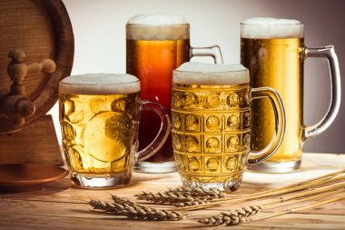 beer barrel and glasses of beer