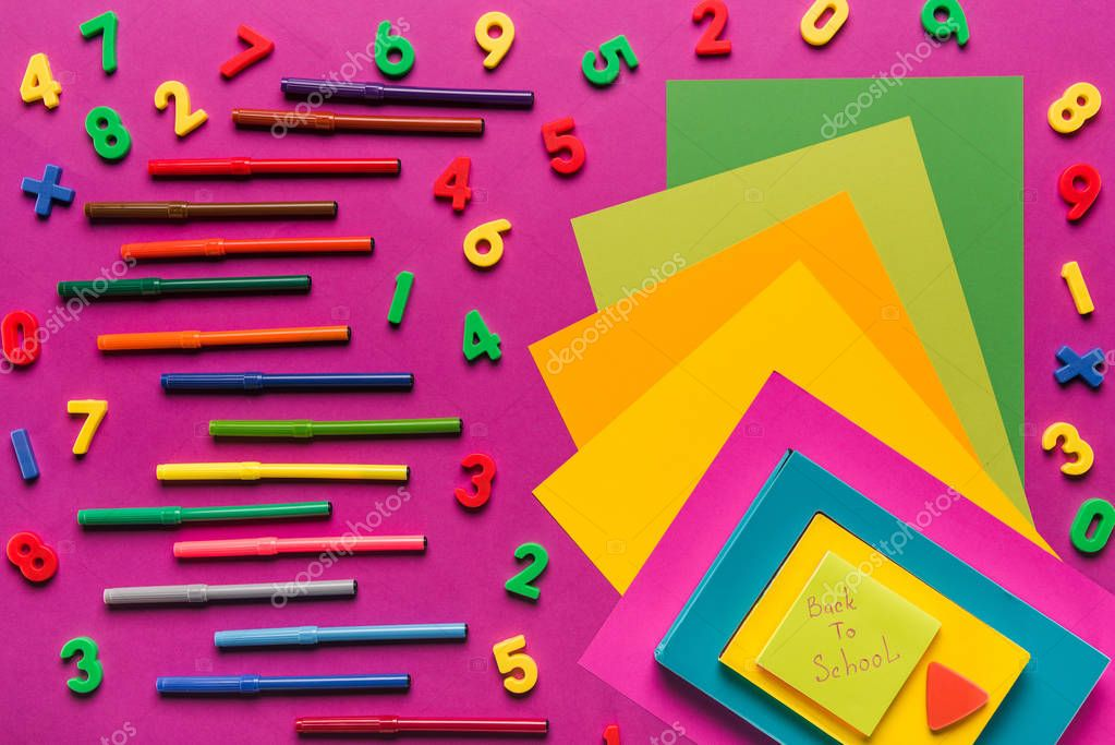 composition of colorful papers and markers