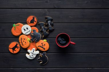 Halloween cookies and cup of coffee