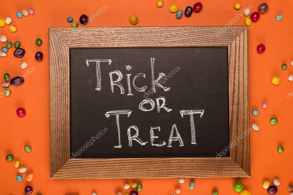 chalkboard with trick or treat inscription