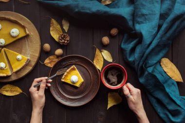 Woman eating pumpkin tart