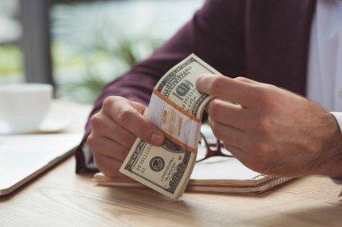 businessman holding dollar banknotes